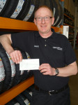 Melksham tyre firm raises £850 for hospice