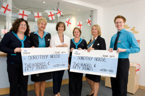 Coventry staff present the cheque.