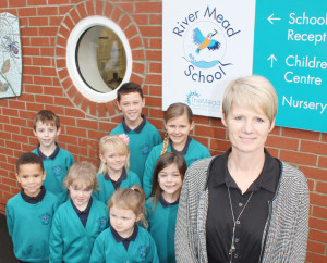 Big smiles for River Mead pupils and headteacher Nicki Henderson