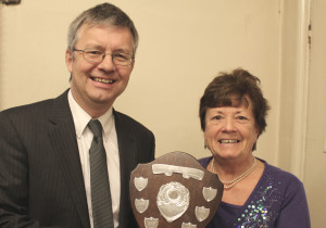 Melksham Independent News editor - Ian Drew presents award to Anne Cranham
