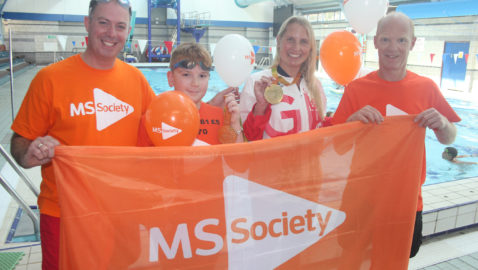 Local lad's swimming challenge inspires others to jump into the pool for charity