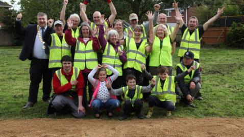 Job done! Brunswick Park volunteers celebrate their new paths